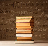 Books on vintage background with math formulas Royalty Free Stock Photos