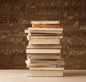 Books on vintage background with math formulas royalty free stock image