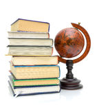 Books and vintage globe on white background Royalty Free Stock Photo