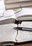 Books and volumes on the table. Shallow depth of field royalty free stock image