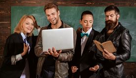 Books vs computer Education. Teacher and students. Lesson and education in high school. Group of students. Books vs. Computers Essay Example for Free royalty free stock images