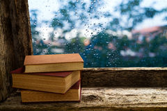 Books on the windowsill Stock Image