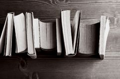 Books on wood, b&w royalty free stock photography