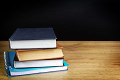 Books on wood table Royalty Free Stock Photography