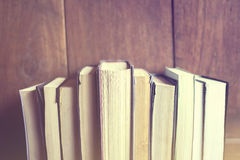 Books on a wooden background Stock Photography