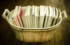 Books in the wooden basket. Vintage background Royalty Free Stock Images
