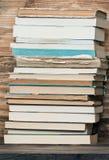 Books on wooden bookshelf Stock Images