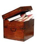 Books in the wooden chest. Books in the chest isolated on white Stock Photo