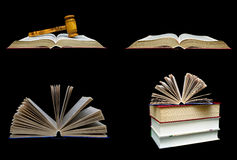 Books and a wooden hammer of the judge on a black background. Stock Image