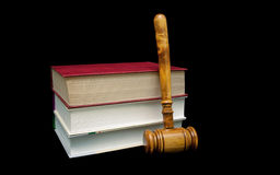 Books and a wooden judge`s gavel on a black background Royalty Free Stock Photography