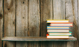 Books on a wooden shelf. Royalty Free Stock Photo