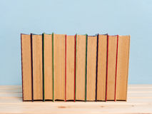 Books on a wooden shelf Stock Images