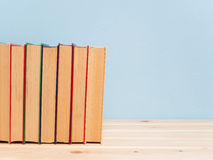 Books on a wooden shelf Stock Photography