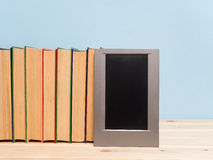 Books on a wooden shelf Stock Photo