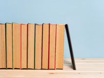 Books on a wooden shelf Royalty Free Stock Image