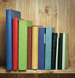 Books on the wooden shelf Stock Images