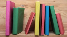 Books on wooden shelf close-up. No labels, blank Royalty Free Stock Photography