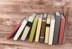 Books on the wooden shelf Royalty Free Stock Image