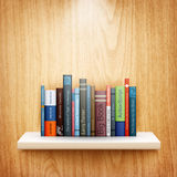 Books on wooden shelf Royalty Free Stock Image