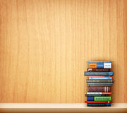 Books on wooden shelf Royalty Free Stock Images