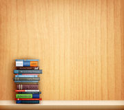 Books on wooden shelf Stock Photography