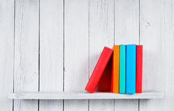 Books on a wooden shelf. Royalty Free Stock Photography