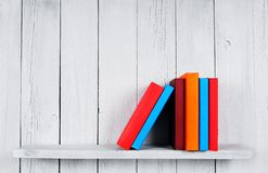 Books on a wooden shelf. Stock Photo