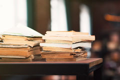 Books on wooden shelfs in the interior. Vintage style royalty free stock image