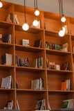 Books on wooden shelves Stock Photos