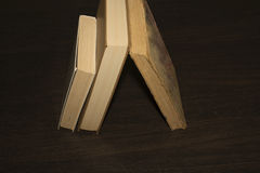Books on a wooden table. New and old Royalty Free Stock Photography