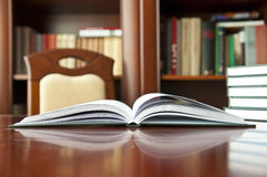 Books on a wooden table. At a library Royalty Free Stock Photo