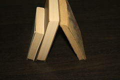 Books on a wooden table. New and old Royalty Free Stock Images