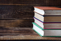 Books on the wooden table. Old books Royalty Free Stock Photo