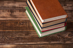 Books on the wooden table Stock Image