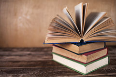 Books on the wooden table. Opened book Royalty Free Stock Photo