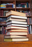 Books on wooden table Stock Photos