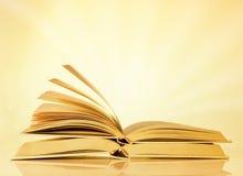 Books on yellow background Stock Image