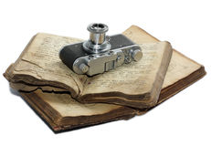 Books & Zorki. Very old film camera and the bible Stock Image