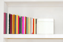 Bookshelf. On the wall with colorful books stock photography