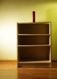 Bookshelf. Antique looking bookshelf has a novel on top of it Stock Images