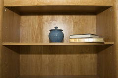 Bookshelf. With books and a pot stock image