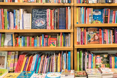 Bookshelf With Books In Library Stock Photo