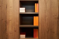 Bookshelf with books in modern library office, interior, close-up. Books on a closet shelf as knowledge and education concept background with copy space for royalty free stock images