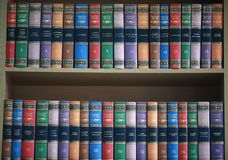 Bookshelf. With books neatly standing with colored covers royalty free stock photos
