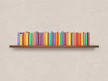 Bookshelf with colorful books on the wall