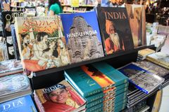 A bookshelf on the counter of a bookstore. India travel guide. Kamasutra stock image