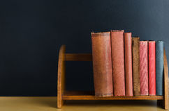 Bookshelf on Desk with Chalkboard Background Royalty Free Stock Photo