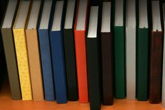 A bookshelf of diaries. Diaries with several vinyl backs standing along a bookshelf Stock Photography