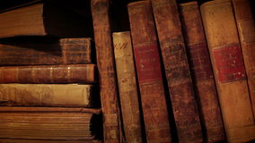 Bookshelf in library. Old thorn books.