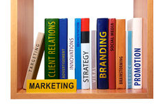 Bookshelf with marketing knowledge and skills. Stock Images